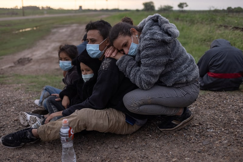 CLINIC statements: A migrant family from Nicaragua seeking asylum in the U.S. waits to be transported to a Border Patrol processing facility after crossing the Rio Grande into La Joya, Texas, May 13, 2021. (CNS photo/Adrees Latif, Reuters)